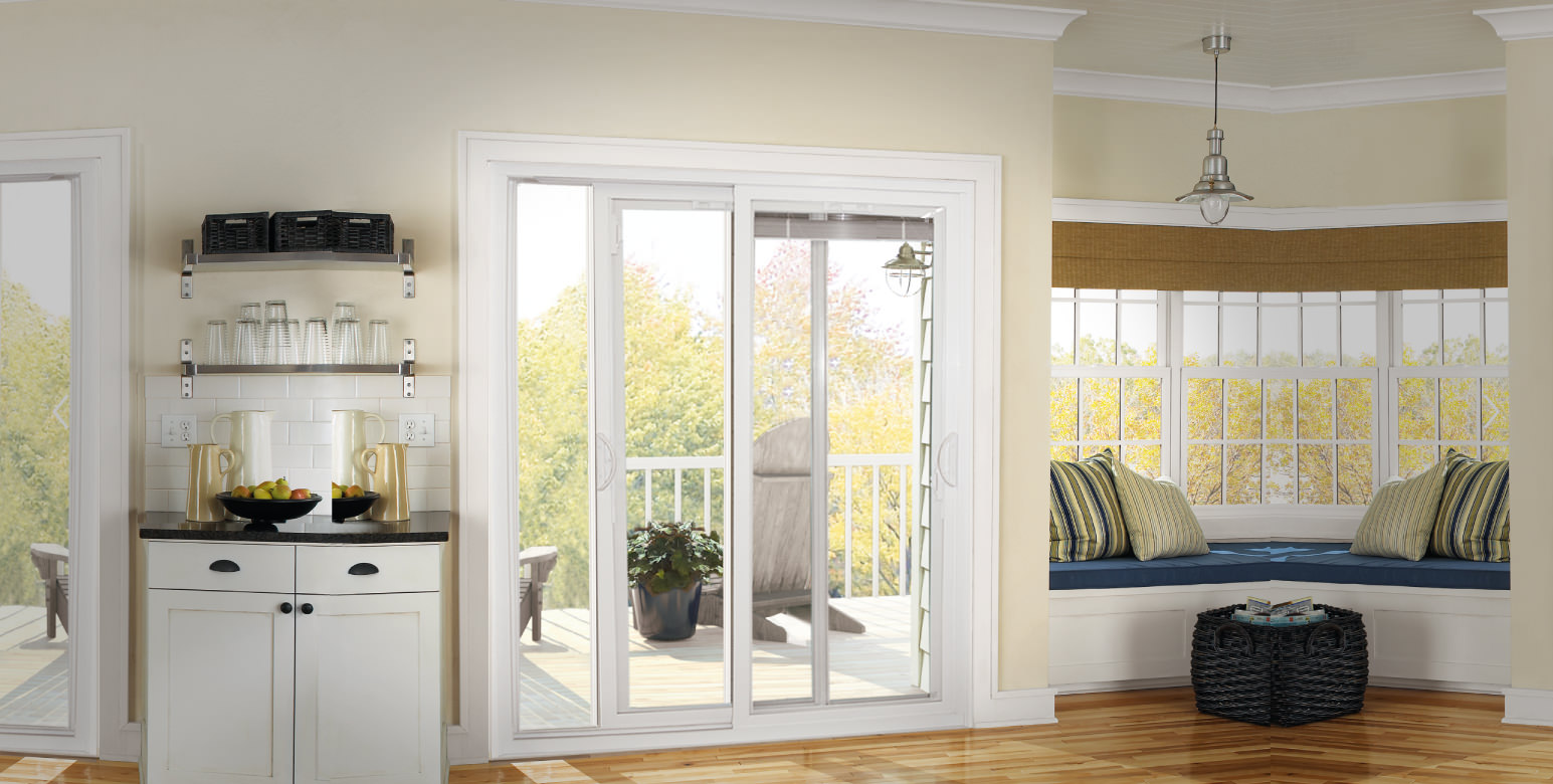 A white patio door in a bright living room area with a pretty view